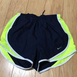 Neon yellow and navy blue Nike tempo shorts